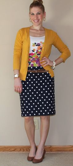 Floral tee with mustard cardigan and polka dot skirt.