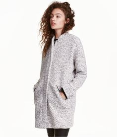 Check this out! Short coat in melange bouclé fabric. Small stand-up collar, dropped shoulders, concealed zip and snap fasteners at front, and welt pockets with flap. Lined. - Visit hm.com to see more.
