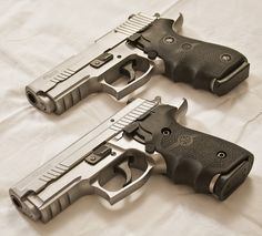 Sig-Sauer P229 Elite Stainless and a P220 Carry Elite Stainless with Hogue grips. One for each side :)