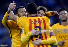 Barcelona's Uruguayan forward Luis Suarez celebrates a goal with teammates Argentinian forward Lionel Messi and Brazilian midfielder Rafinha during...