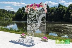 A modern chic spin on a ceremony backdrop for, an outdoor wedding