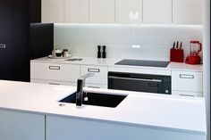 Lacquered cabinetry and a silestone stone benchtop, feature in this highly spec'd kitchen.