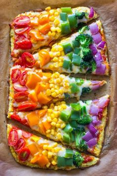 How fun does this rainbow pizza look!? Kids will eat lots of yummy vegetables and have fun making this pizza with you.