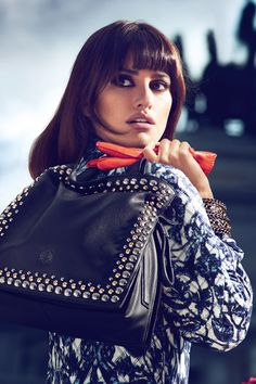 Penelope Cruz For Loewe; the orange gloves make it.