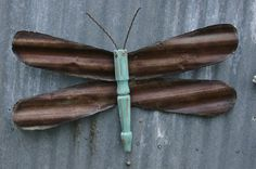 small barn tin dragonfly fence ornament by Repurposedlifeokla on Etsy, $25.00