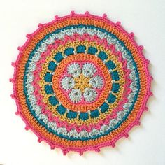 Free African Flower crochet mandala pattern featuring bright colors and cotton yarn.