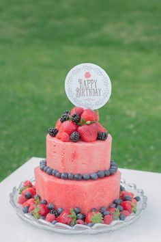 Rustic Books and Berries Birthday Dessert Table. Fresh watermelon cake topped with various berries! Perfect for the summer heat.