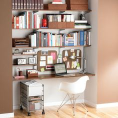 Elfa. Love it. Look how much storage and work space are carved out of this nook. The Elfa file cart is the best on the market. Love the Eames chair too, but The Container Store doesn't carry it.
