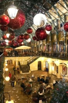Covent Garden, a popular shopping area in central London (near the London Transport Museum) with its Italian-themed piazza, pretty arched gallery, and iron and glass market halls decked out splendiforously for Crimbo. There are a veritable cornucopia...