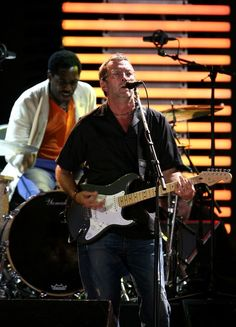 Eric Clapton and Steve Jordan Photos Photos - Drummer Steve Jordan (L) and musician Eric Clapton perform during the Crossroads Guitar Festival 2007 held at Toyota Park on July 2007 in Bridgeview, Illinois. Steve Jordan, Jordan Photos, Eric Clapton, Munich, Illinois, Guitar, July 28, Concert, Toyota