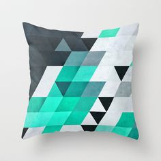 Want to start looking into getting a series of similar geometric cushions - mynt Throw Pillow by Spires - $20.00