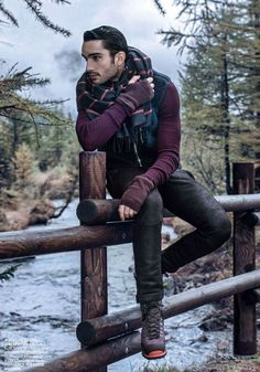 Pair a dark blue gilet with black skinny jeans to get a laid-back yet stylish look. Channel your inner Ryan Gosling and throw in a pair of purple suede boots to class up your look.  Shop this look for $248:  http://lookastic.com/men/looks/scarf-gilet-crew-neck-sweater-gloves-skinny-jeans-boots/6270  — Red and Navy Plaid Scarf  — Navy Gilet  — Purple Crew-neck Sweater  — Purple Wool Gloves  — Black Skinny Jeans  — Purple Suede Boots