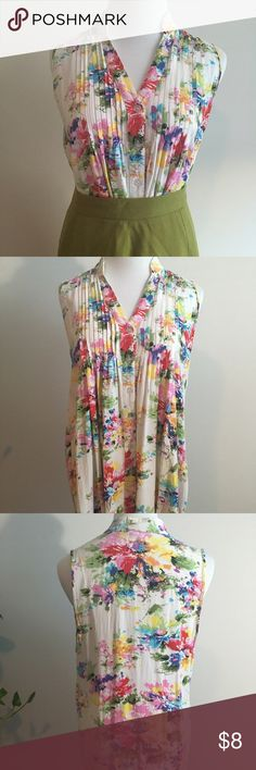 Toska Floral Button Up Blouse/Tunic Sleeveless Floral button up Blouse by Toska. 100% rayon. One small hole as pictured. Size Medium. 29 inches long so could be worn as a tunic with leggings as well. Tops Tunics