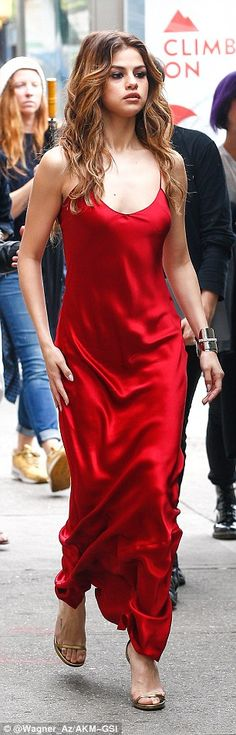 On a roll: Later, she donned dress number two, which was a full length satin frock with spaghetti straps and a low-cut neckline