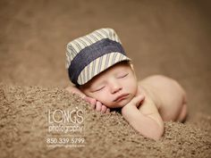 Tallahassee baby and family photographer, Linda Long of Long's Photography, captures this timeless moment with newborn baby boy on soft brown with striped hat cap