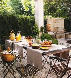 Veranda Magazine, outdoor dining table, stone fountain, edited by lb for linenandlavender.net, http://www.linenandlavender.net/2011/07/patience-my-dear.html