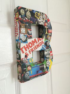 Decoupage initial for my sons bedroom door ... Thomas of course!