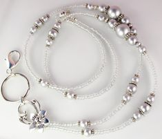 A beaded lanyard that is sure to impress, Gray Castle is a beautifully crafted handmade original. Made with high quality Swarovski light gray crystal pearls, gray lined crystal glass seed beads, silver-plated spacers, this lanyard is stunning. To ensure durability, I use strong wire, a Pearl Beads, Crystal Beads, Glass Beads, Crystal Bracelets, Beaded Lanyards, Id Badge Holders, Silver Pearls, 925 Silver, Pearl Grey