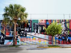 Graciela Cattarossi Artists were commissioned to create the graffiti-style murals covering the Wynwood Walls.