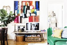 Bold, colourful art in the sitting room of the happy Swedish home of Elsa Billgren. Photography: Beata Holmgren.