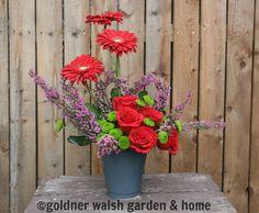 Valentine's Day arrangement designed by Goldner Walsh floral designer. Feat. Gerbera daises, red roses, heather, & kermits.