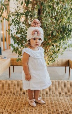 You'll love thisCUTE beanie in with the sweetestrainbow! It's topppedwith a pom pom and hand knit. It fits ages 2-6 on average!