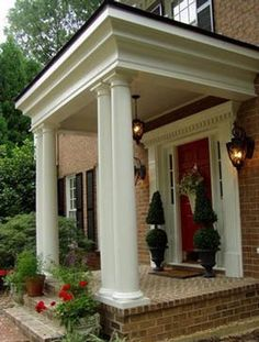 LOVE this entry-way with the columns, just not sure it would work at my house!