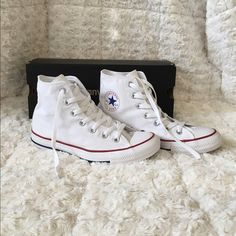 White High Top Converse Brand New! Never worn! Got the wrong size and planned on returning but my boyfriend paints and accidentally spilled ONE drop of paint on the right shoe (pictured) it's literally my luck haha but my loss your gain if you can get it out! Or even just cover it up  other than that they are perfect! Size Women's: 8! Men's: 6. I paid $55+ tax so I'm ✨FIRM ON PRICE. No trades, No PayPal, No Ⓜ️✨  comes with box! Converse Shoes Sneakers