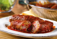 Beef Braciole. Thinly sliced beef is rolled around a mixture of sautéed veggies and breadcrumbs and served in a red sauce