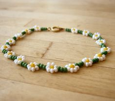 Daisy Chain Bracelet: Seed Beaded Bracelet, Flower Jewelry, jewelry under 10. £5.73, via Etsy.
