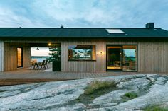 Finnish designers Aleksi Hautamaki and Milla Selkimaki purchased a island two years ago, on the edge of the Archipelago National Park in Finland, and have since built this self-sufficient summer house that includes a sauna, a guesthouse and a Eco Casas, Ideas De Cabina, Scandinavian Cabin, Summer Cabins, Timber Cabin, Timber Cladding, Wooden Decks, Sauna, Cabin Homes