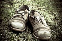 Photos of Worn Out Shoes | Old, worn out, broken shoes on grass