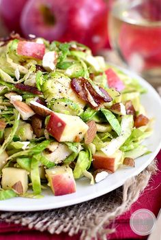 Apple, Almond, Bacon and Brussels Sprouts Salad with warm bacon dressing is a fresh and spring salad with lots of crunch!