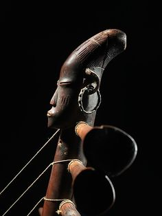 Figurative Harp (Domu) detail - 19th–20th century - Democratic Republic of the Congo - Mangbetu peoples - Wood, hide, twine, brass ring
