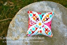 Catheral window pincushion.  I would love to make a quilt or at least a pillow using this technique.