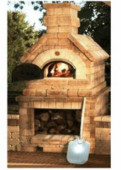 His very own Chicago Brick wood burning oven? It's not just for pizza! - Outdoor Kitchen Bars about you searching for. Outdoor Pizza Oven Kits, Brick Oven Outdoor, Brick Bbq, Brick And Wood, Outdoor Kitchen Bars, Outdoor Kitchen Design, Outdoor Cooking, Outdoor Kitchens, Stone Pizza Oven