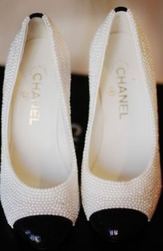 Pearl Flats. I'm not much of a girly girl and I know I'd never wear these (or afford them) but I gotta say...they are really cute! Pearls are so classic and elegant.