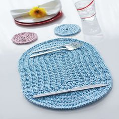 Crochet a placemat and coaster set that will look great on your table all year long!