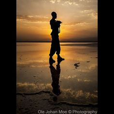 Sunset over a salt lake in the Danakil Depresion, Northern Ethiopia. This place…