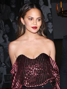 Chrissy Teigen Wore the Chicest Outfit to L.A.'s Buzziest New Hotspot via @WhoWhatWear  One of the biggest trends of the summer was the off-the-shoulder look, and style icon/fan favorite Chrissy Teigan helped carry this trend over into the Fall, (well, for those who get the please of LA weather in the fall)  Andrea Wiedman