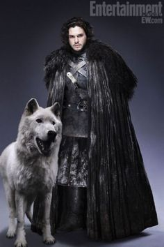 Jon Snow in black cloak, with his direwolf, Ghost.