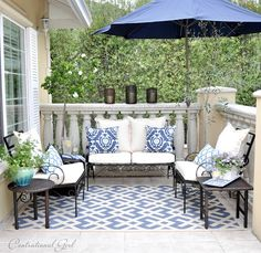 For outdoor spaces, sometimes all you need is ONE accent color (and varying shades of it) along with lots of whites and neutrals. Looks really great!!  by centsational girl