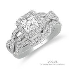 Love this Mesmerizing 14K White Gold Diamond Halo Engagement Ring with vibrant surrounding diamonds.