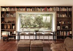 House for an artist on the outskirts of Bogota.  Eclectic furnishes bring warmth and color to the rectilinearity and geometry of the house. A 20 foot bookshelf filled with books, ornaments and objects from across the world  encloses a concrete window seat that frames the exterior's lush green gardens.