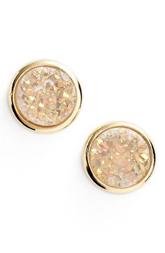 Could wear these stunning gold stud earrings everywhere.