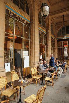 Café Le Nemours ― Café Le Nemours is one of the most famous cafés in Paris. When you see it across Place Colette, it's easy to understand why. Take a virtual tour of Place Colette and Café Le Nemours on google street view~ https://maps.google.com/maps?q=place+colette,+paris=en=48.862964,2.336354=0.021626,0.043945=37.0625,-95.677068=52.77044,90=Place+Colette=m=15=c=48.862996,2.336224=-0sLKGcQY3O9Zcl__L3rOQ=12,13.97,,0,7.47.  #Paris #CafeLeNemours