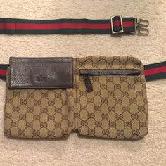 """Gucci original GG canvas belt bag Lightly used canvas belt bag. Excellent condition .Beige/ebony original GG canvas Brown leather trim Adjustable waist or shoulder strap with Gucci trademark engraved clip closure. Rear zip pocket Small 11.5""""L x 1.0""""W x7""""H Made in Italy Adjustable green/red/green strap Gucci Bags Mini Bags"""