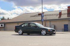BRG BMW e36 sedan on OEM BWM Styling 21 wheels aka Throwing stars