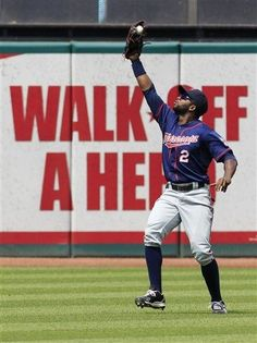 Minnesota Twins' Denard Span catches a ground ball hit by Cleveland Indians' Shin-Soo Choo in the seventh inning of a baseball game, Wednesday, Aug. 8, 2012, in Cleveland.