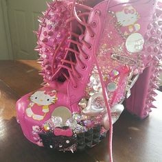 Hello kitty pink glitter heels custom boots Pink hello kitty heels with silver glitter spikes on back of heels and custom design with mirrors and hearts and sparkle bow hello kitty decorations. Bought them off etsy. Size 10. Heel is about 4.5 inches high. About one inch wide. Shows some signs of wear evident in pictures. etsy Shoes Heeled Boots